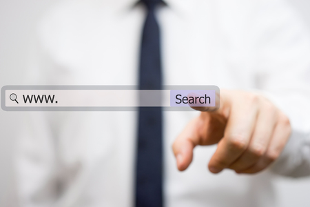 businessman is using internet search bar to find the solutions Standard-Bild