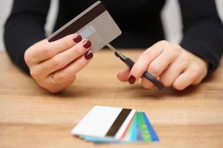 intrest: woman is destroying  credit cards because of big debt