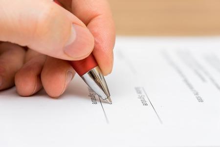 Closeup of businessman  signing contract Standard-Bild