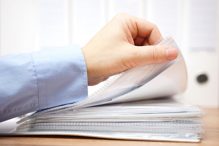 bookkeeper is reviewing invoices and documentation Stock Photo