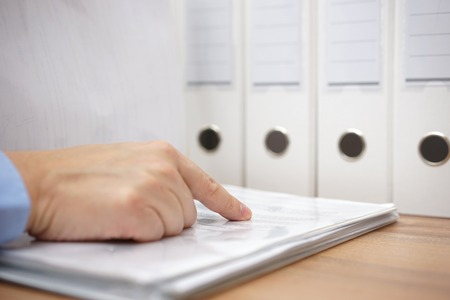 file clerks: Businessman leafing through a documentation