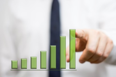 businessman showing growing bar graph