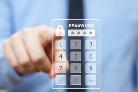 cuenta bancaria: hombre de negocios presionando código de seguridad en teclado virtual