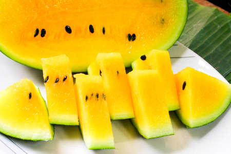Yellow flesh watermelon cut and serve creatively.