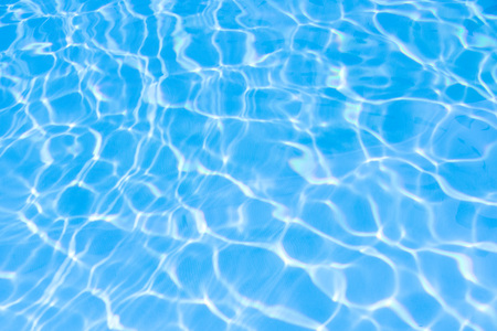 Water in swimming pool blue background