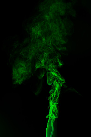 Green coloured smoke abstract lighting on a black background Reklamní fotografie