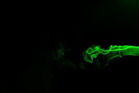 Green coloured smoke abstract lighting on a black background Stock Photo