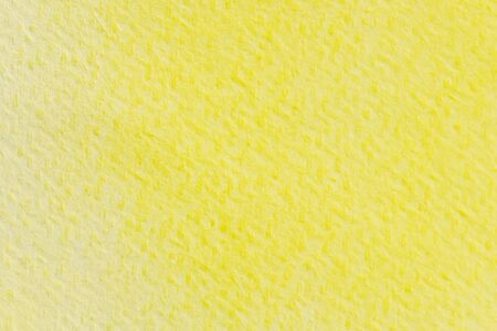 Abstract yellow watercolor painting textured on white paper background