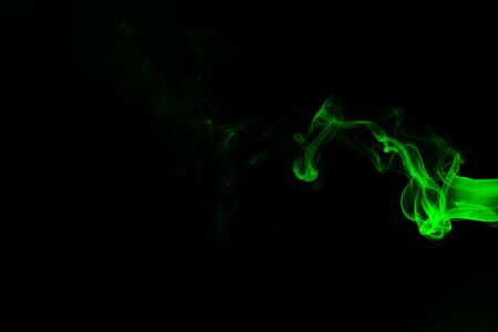 Green coloured smoke abstract lighting on a black background Stockfoto