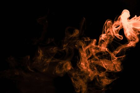 Brown coloured smoke abstract lighting on a black background Stockfoto