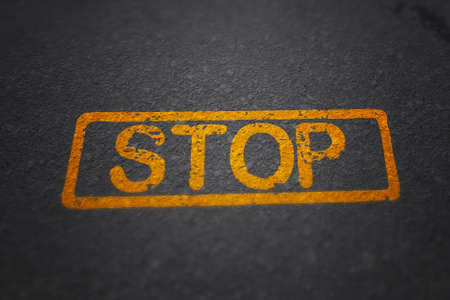 Stop Painted on the Road Stock Photo - 23838727