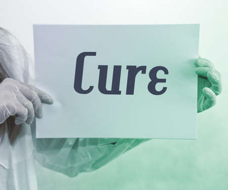 Doctor Holding Cure Sign photo