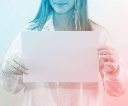 Doctor Holding Blank Paper photo