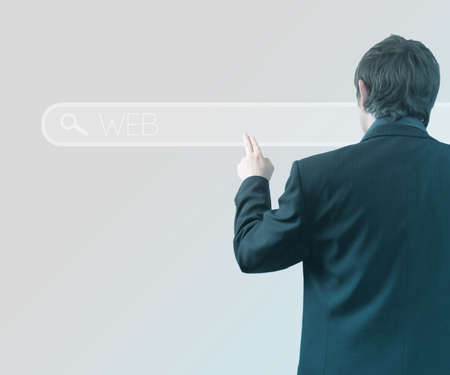 Businessman Using Touch Screen Web photo