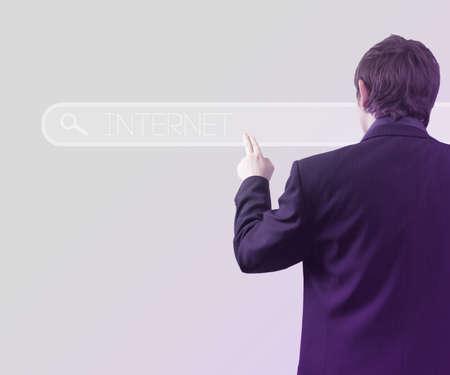 Businessman Using Touch Screen Internet Bar photo
