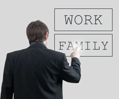 Businessman Chooses Family not Work photo