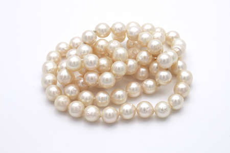 Closeup Pile of Pearls Isolated on White Background