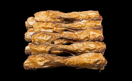 flesh eating animal: Group of Dried Fish Isolated on Black Background with Clipping Path