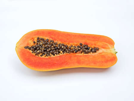 Papaya Cut in Half with Seeds Isolated on White