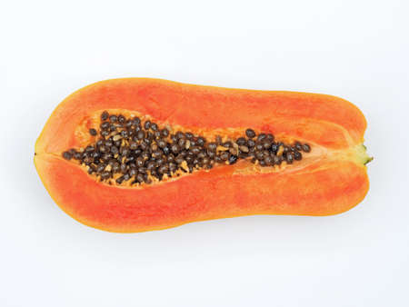 Top View of Papaya Cut in Half with Seeds Isolated on White
