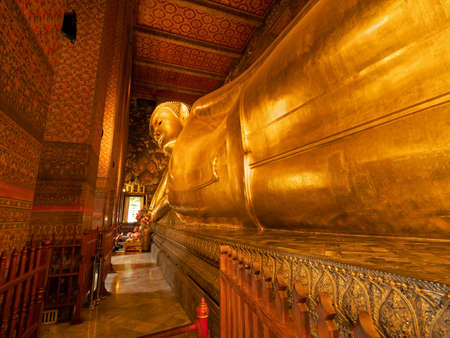 Closeup Reclining Buddha Statue at Temple in Thailand