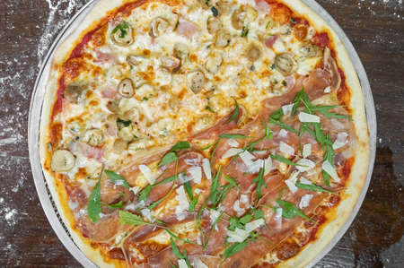 Top View of Two Flavors Italian Pizza on Wooden Table