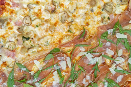 Close up Two Flavors Italian Pizza on Table for Background Фото со стока - 166506661