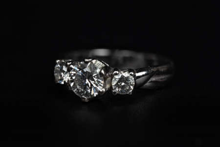 Close up Silver Diamond Ring Isolated on Black Background Фото со стока