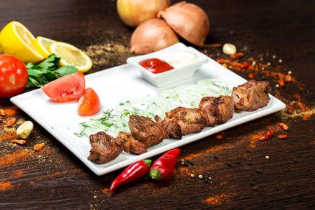 fillet steak: fresh raw beef fillet steak red meat brisket on skewers barbecue brazier grid full burned charcoal