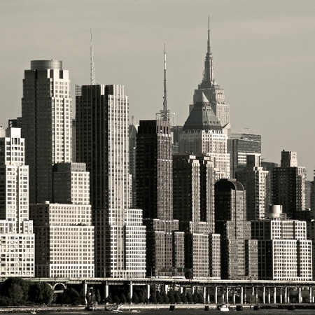 New York Citys West Side highway with newer residential towers descending in height towards the South.  The Empire State Building can be seen in the background. Stock Photo