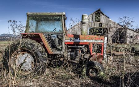abandoned farmhouse abandoned farmhouse: Tractor and Old Barn, Color Image, USA Stock Photo