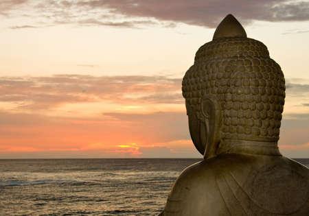 the setting sun: Side view of Buddha overlooking the setting sun