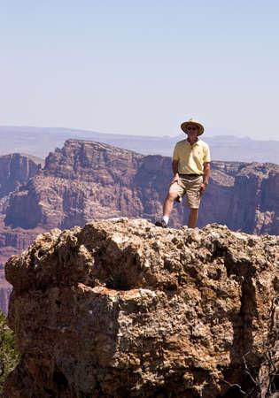 Man facing camera on rocks of Grand Canyon Stock Photo - 2558649