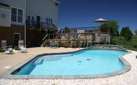 Backyard pool in rear of modern house in suburbs