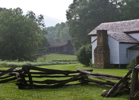 White wooden farm buildings with rustic fence in Smoky Mountains photo