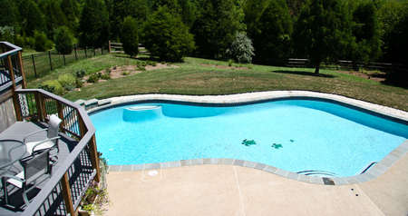 Backyard Pool in summer with surrounding multi-level deck Stock Photo - 2854964