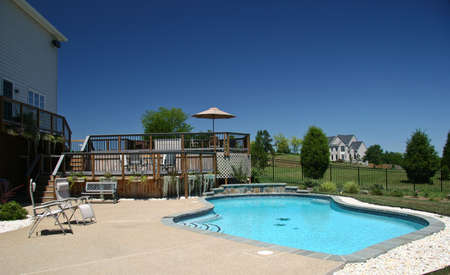 Backyard Pool in summer with surrounding multi-level deck Stock Photo - 2854917