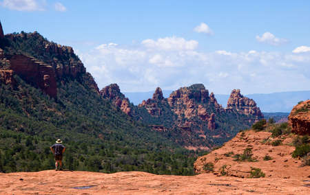 Rear shot of single hiker overlooking the red rock in Sedona Stock Photo - 2923097