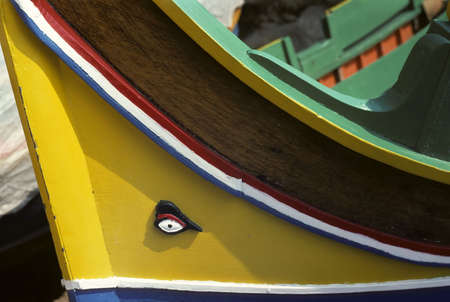 prow: Bow of wooden sailing boat with carved eye on the prow Stock Photo