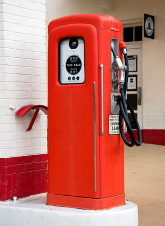 Close up of an old vintage gas petrol pump in place when gas was very inexpensive photo