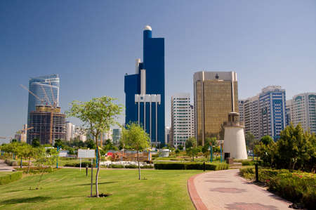 View of Abu Dhabi Skyline with gardens and small lighthouse in foreground Stock Photo - 3798003
