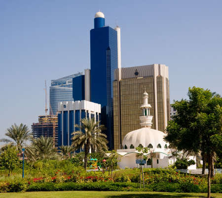 Group of office skyscrapers in Abu Dhabi with a small mosque in the foreground Stock Photo - 3995865