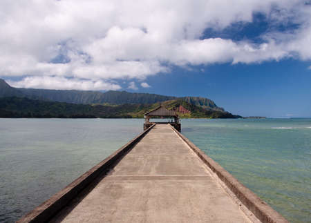 View down the pier at Hanalei in Kauai towards the Na Pali coast photo