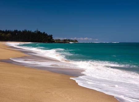 shorebreak: Waves breaking onto Lumahai beach on the north coast of Kauai