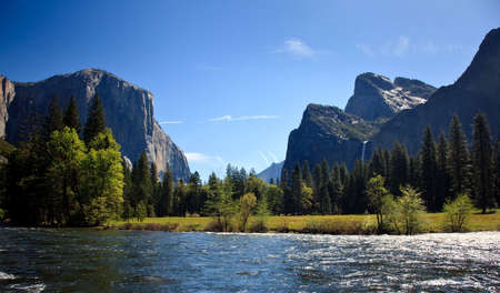 merced: View into Yosemite valley over a shining Merced river showing entrance waterfalls Stock Photo