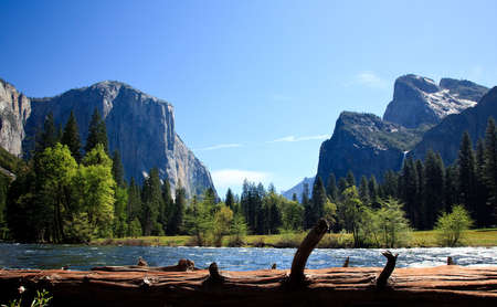 Cedar colored log frames the entrance into Yosemite Valley photo