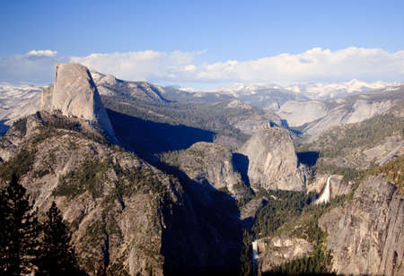 Half Dome with the Sierra Mountains and waterfalls in the distance Stock Photo - 5300256