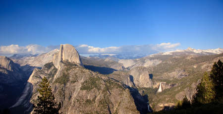 Panorama format of Yosemite Valley with Half Dome at sunset photo