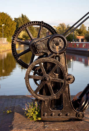 Black steel crane by the waterside in Shropshire photo