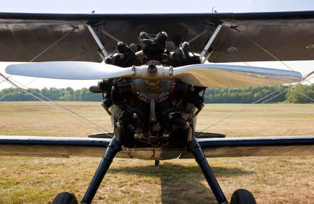 Close up of the engine and propellor of antique biplane photo